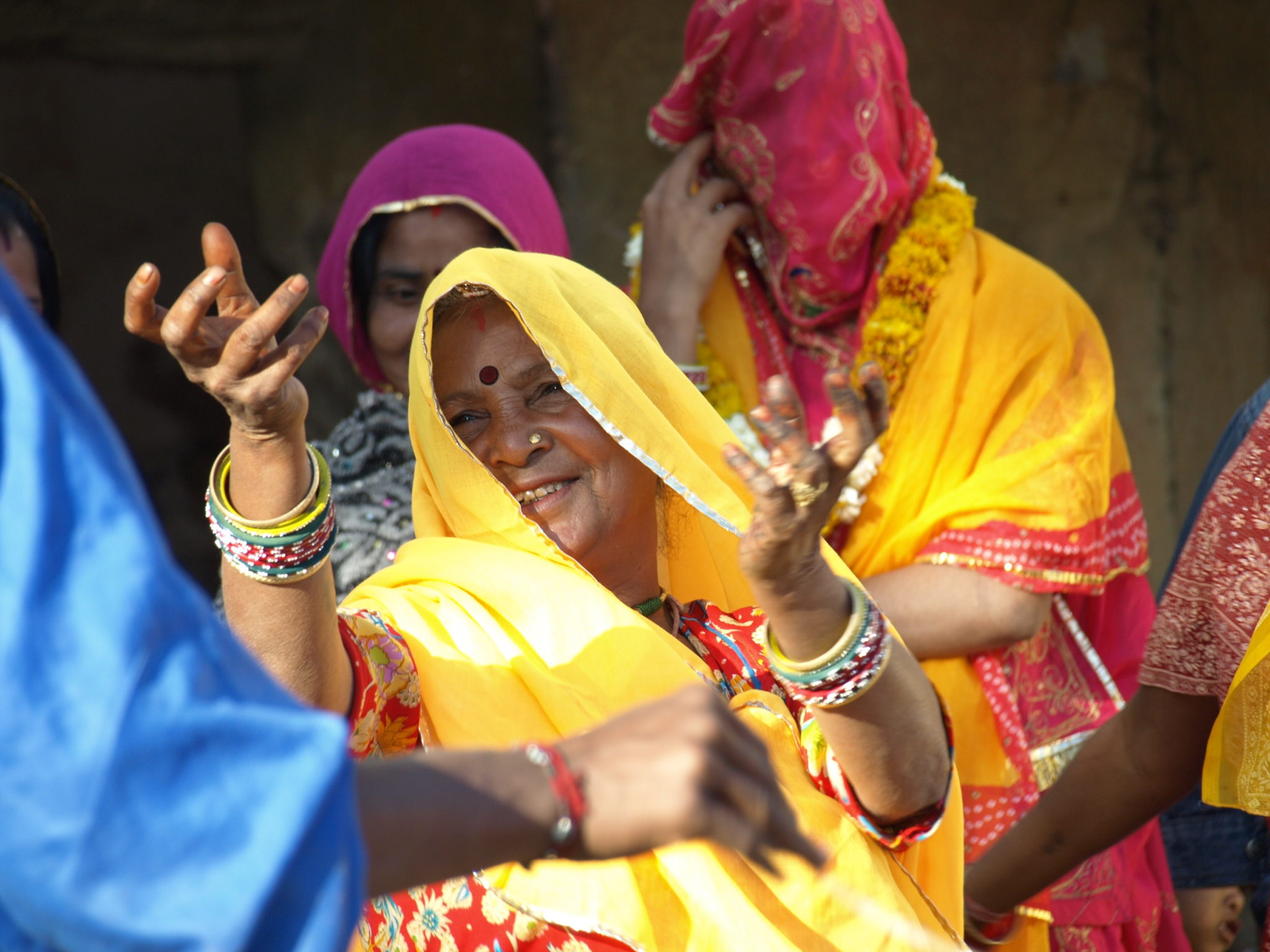 Rajasthani ceremony with the dancing women in traditional outfit. India holiday packages with a difference.